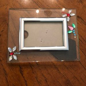 Glass picture frame with rhinestone dragonflies.